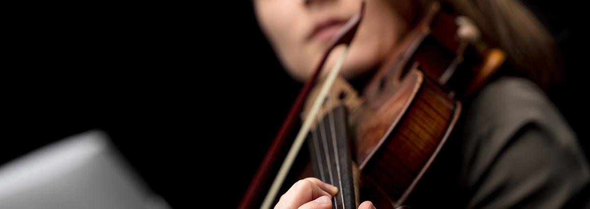 Close up intermediate violinist