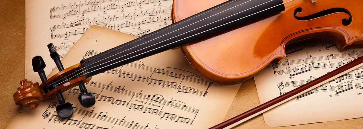 violin over music sheets