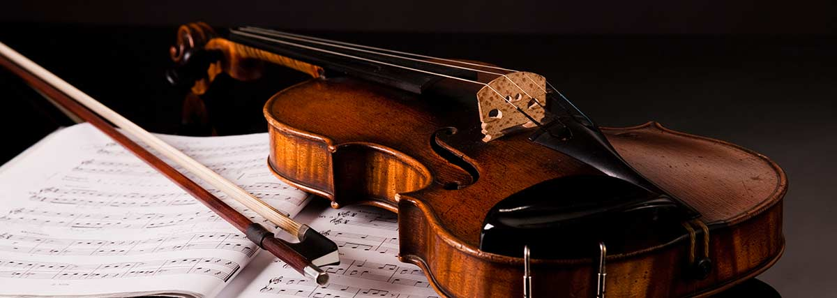 a-violin-a-bow-and-music-piece