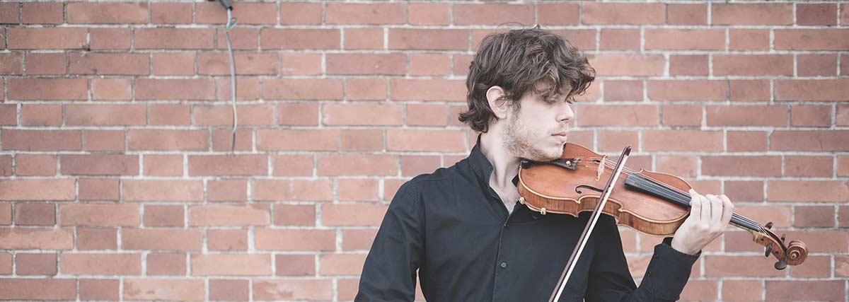 man playin violin outside