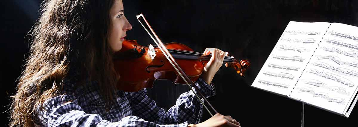 violinist reading her music