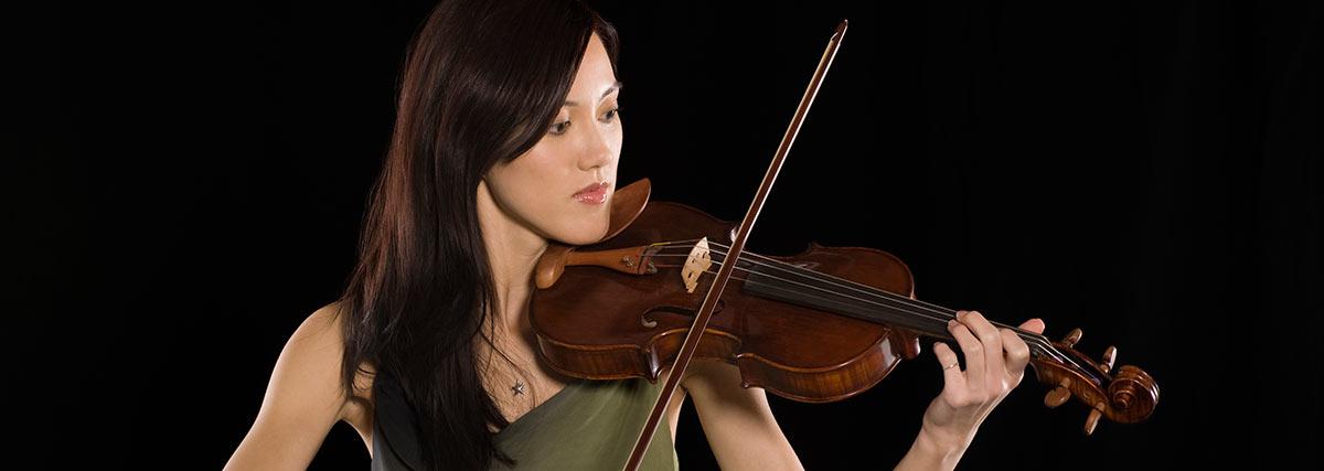 woman practising the violin